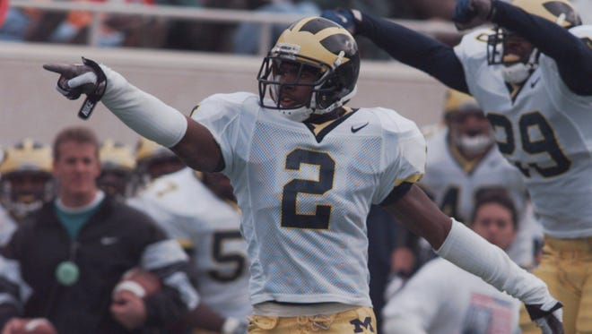 Michigan's Charles Woodson celebrates his second interception of the day against MSU on Oct. 25, 1997.