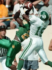 Renaldo Hill (15) played for MSU from 1997 to 2000 and is best remembered for his end zone interception that sealed the Spartans' 28-24 upset of then-No. 1 Ohio State in 1998. Like his older brother, Ray, Renaldo started three seasons and earned first-team All-Big Ten honors from the league's coaches as a senior in 2000. He was taken in the seventh round of the NFL draft by Arizona the following spring.