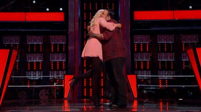 """Cali Tucker hugs Ryan Whyte Maloney after he bested her Tuesday on """"The Voice."""""""