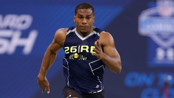 Feb 23, 2014; Indianapolis, IN, USA; Washington Huskies running back Sankey Bishop runs the 40 yard dash during the 2014 NFL Combine at Lucas Oil Stadium. Mandatory Credit: Brian Spurlock-USA TODAY Sports