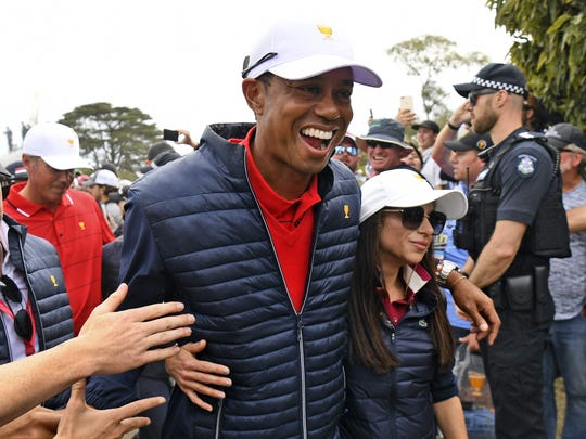 United States playing team captain Tiger Woods celebrates with girlfriend Erica Herman after the U.S. won the Presidents Cup in Melbourne on December 15, 2019. (Photo: William West/AFP)