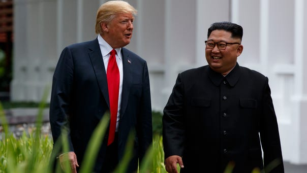President Donald Trump walks with North Korean leader