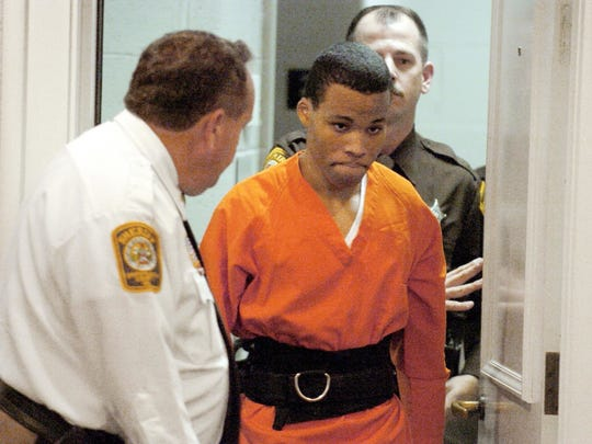 In this Oct. 26, 2004 file photo, Lee Boyd Malvo enters a courtroom in the Spotsylvania, Va., Circuit Court. Malvo plead guilty and was sentenced to two life sentences for the murder of Kenneth Bridges and shooting Caroline Seawell in 2002. In June 2017, public defender James Johnston argued before a Maryland judge that Malvo, one of the D.C. snipers who terrorized the Washington area for a month in 2002, deserved a new sentence. He was 17 and pleaded guilty to murder charges in Virginia and Maryland. He received life without parole in both states, but a Virginia judge recently ruled the term unconstitutional and ordered Malvo resentenced. (Mike Morones/The Free Lance-Star via AP)