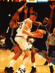 Arturas Karnishovas (center) playing for Seton Hall in 1993