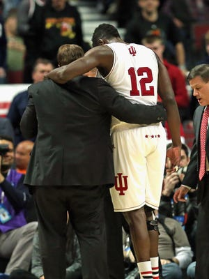 Hanner Mosquera-Perea #12 of the Indiana Hoosiers is helped off of the court after suffering an injury against the Northwestern Wildcats during the second round of the 2015 Big Ten Men's Basketball Tournament at the United Center on March 12, 2015 in Chicago, Illinois. Indiana defeated Northwestern 71-56.