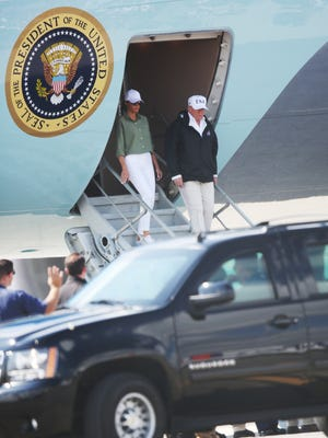President Donald Trump and First Lady Melania Trump arrive Thursday at Southwest International Airport in Fort Myers. The President will be visiting areas that were ravaged by Hurricane Irma.
