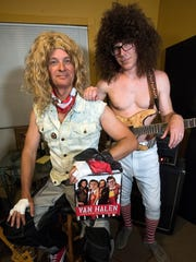 Stephen Pitre, as David Lee Roth, and Jim Green, as Eddie Van Halen, pose for a photo Wednesday, Sept. 13, 2017.