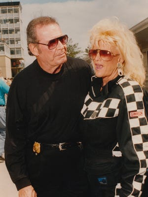 Linda Vaughn, best known as Miss Hurst Golden Shifter, chats with actor James Garner on Carb Day at the Indianapolis Motor Speedway on May 27, 1994.