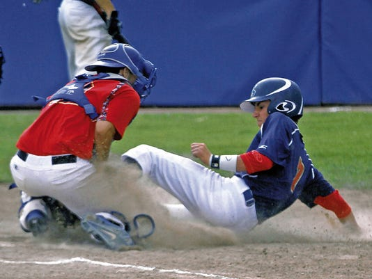 SZ Scanlan catcher Chris Garcia tags out SZ Morrissey's Bryce Washburn at home during Friday's game at Ricketts Park in Farmington.