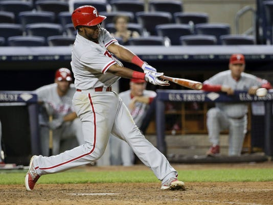 Philadelphia Phillies' Maikel Franco doubles down the third base line to drive in two runs against the New York Yankees during the ninth inning. It marked the second straight game Franco has driven in five runs.