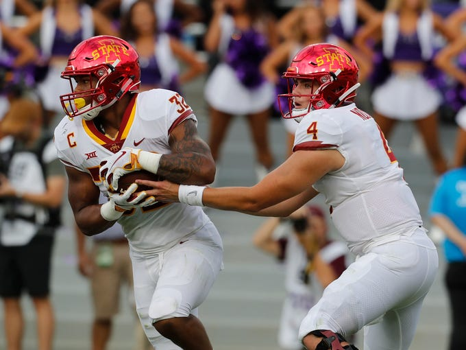 Iowa State running back David Montgomery (32) takes the hand off from quarterback Zeb Noland (4) in the first half of a NCAA college football game in Fort Worth, Texas, Saturday, Sept. 29, 2018. (Bob Booth/Star-Telegram via AP)