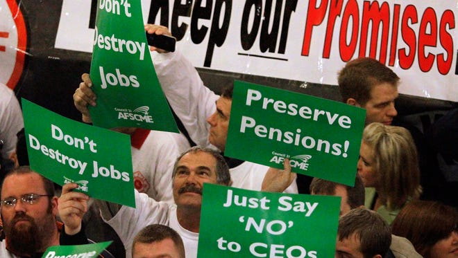 This 2011 photo shows protests against pension reform in Illinois. The state ranks dead last when it comes to fiscal solvency, says a new report, due in part to unfunded pension obligations.