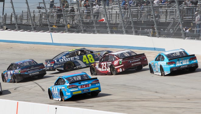 Jimmie Johnson spins after igniting a multicar wreck during the AAA 400 Drive For Autism at Dover International Speedway.