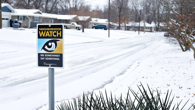 A Neighborhood Watch sign stands at the entrance of South Karla Avenue.