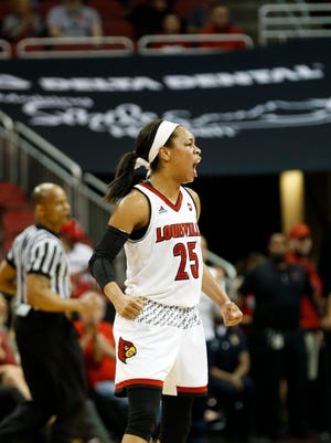 Louisville's Asia Durr reacts after making a basket. 