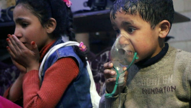 This image released early April 8, 2018 by the Syrian Civil Defense White Helmets, shows a child receiving oxygen through respirators following an alleged poison gas attack in the rebel-held town of Douma, near Damascus, Syria. Syrian rescuers and medics said the attack on Douma killed at least 40 people. The Syrian government denied the allegations, which could not be independently verified. The alleged attack in Douma occurred Saturday night amid a resumed offensive by Syrian government forces after the collapse of a truce.