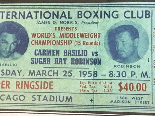 A ticket stub from the rematch for the middleweight crown, which Carmen Basilio lost to Sugar Ray Robinson, is one of the items that's on display through September at the Town of Irondequoit Public Library.