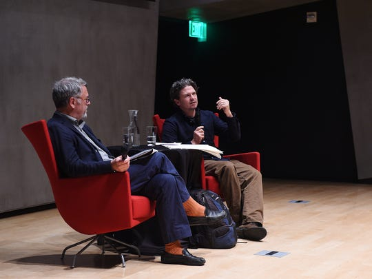 """Artist Dave Eggers, right, participates in a discussion about his exhibition """"Insufferable Throne of God"""" at the Nevada Museum of Art in Reno on April 2, 2015. Nion McEvoy, chairman and CEO of Chronicle Books, is seen on the left."""