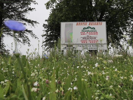 A sign advertises lots for sale in the Rustic Heights