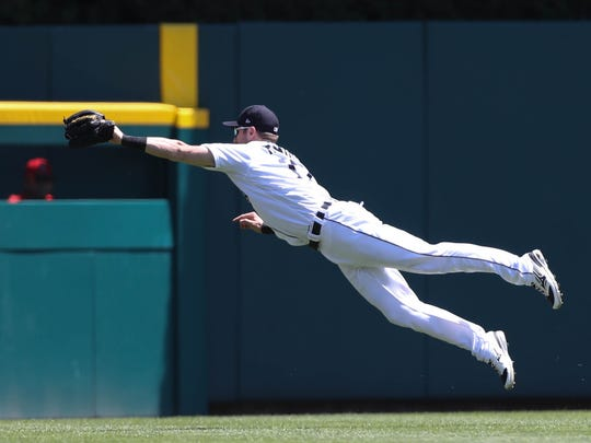 Tigers centerfielder Andrew Romine catches a fly ball hit by Angels leftfielder Ben Revere during the fifth inning of the Tigers' 11-4 loss Thursday at Comerica Park.