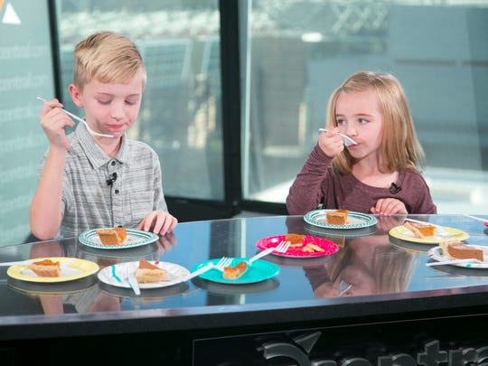 Griffin Wilson, 8, and his sister, Harper Wilson, 5, taste test five different store bought pumpkin pies in the azcentral studios in Phoenix on November 2, 2016.
