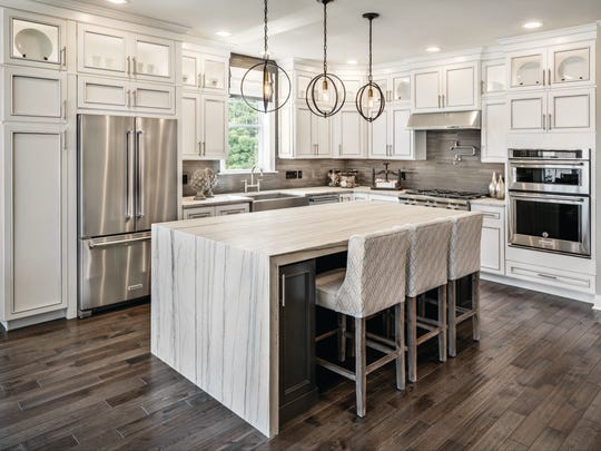 Streaming countertops down on either side of an island creates a waterfall effect and adds a fresh, luxurious feel to your kitchen.