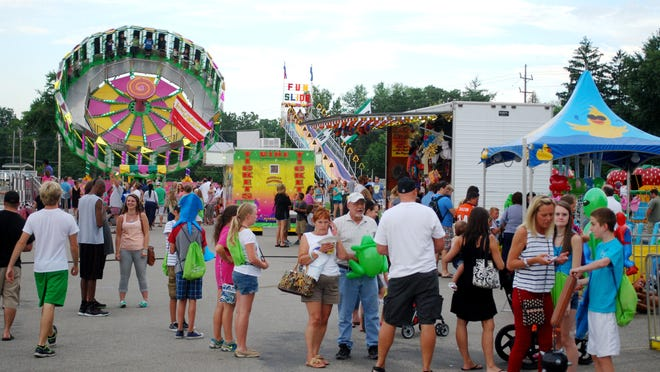 Crowds gather near the rides and game booths during Greater Anderson Days.