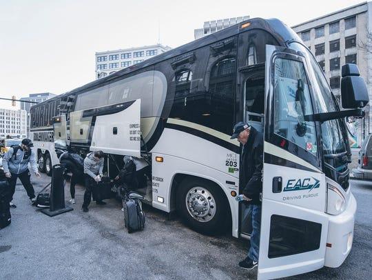 Gene Keady leaves the team bus in Detroit, where Purdue