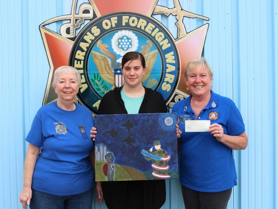 Kayley Vines (center) was recently awarded a $50 check