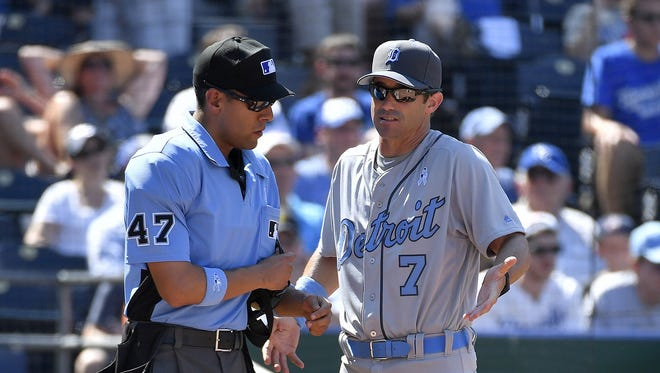 Detroit Tigers manager Brad Ausmus talks with home plate umpire Gabe Morales after Cameron Maybin was ejected from the game during the 11th inning on Sunday, June 19, 2016, at Kauffman Stadium in Kansas City, Mo.