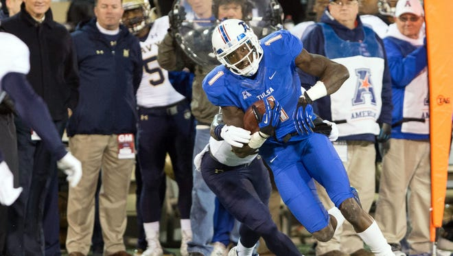 Tulsa Golden Hurricane wide receiver Keyarris Garrett (1) turns up field after the catch against the Navy Midshipmen in a 44-21 loss at Skelly Field at H.A. Chapman Stadium. Garrett is second in the nation in pass receiving yards and yards per game.