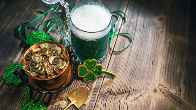 St. Patricks Day concept with gold coins, green beer and clover leaf