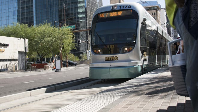 Residents use light rail during the afternoon hours in downtown Phoenix.  Valley Metro CEO Scott Smith says he hopes to fix the light rail's public image by implementing a new code of conduct that prohibits unruly behavior and gives light-rail security guards more flexibility to remove passengers. Valley Metro says there has been an increase in bad behavior on the light rail — actions that don't rise to a criminal offense but do cause other passengers to feel unsafe or uncomfortable.