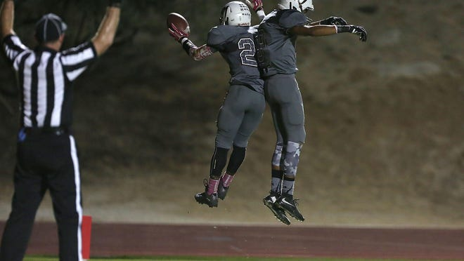 Steven Knight (left) of Rancho Mirage celebrates his touchdown during the Rattlers win Friday.