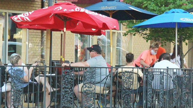 Diners are taking advantage of the weather and the part of Phase 3 of Gov. JB Protzker's reopening plan for Illinois by dining outdoors at DeLong's Casual Dining and Spirits Tuesday evening.