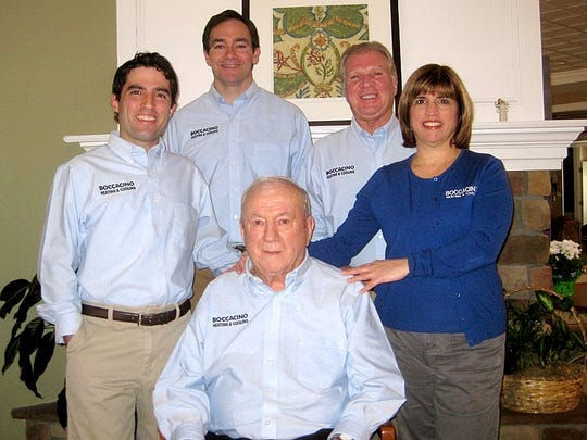 Company founder Michael Boccacino surrounded by his
