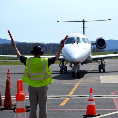 An airplane moves down the runway at Shenandoah Valley