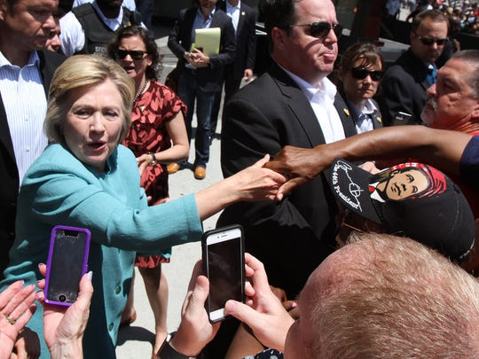 Democratic Presidential candidate Hillary Clinton shakes hands with people outside the former Trump Plaza during a campaign stop in Atlantic City, NJ, Wednesday, July 6, 2016