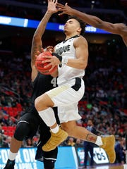 Purdue guard  Carsen Edwards (3) goes to the basket in the second half against the Butler Bulldogs in the second round of the 2018 NCAA Tournament at Little Caesars Arena in Detroit.