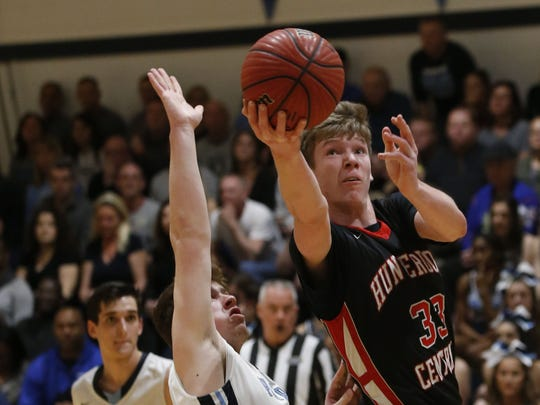 Tucker Richardson (33) of Hunterdon Central goes to the basket against  Ryan Cardone (5) of Freehold Twp. during NJSIAA sectional final at Freehold Twp. High School.
