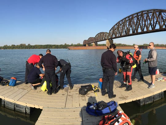 Members of the Henderson dive team train in warmer
