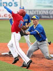 Moeller's Kyle Butz tags Conner's John Frommeyer before firing to first to double up Cody Ware during their baseball game at Florence Freedom Park April 30.