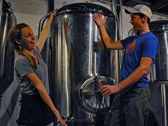 John Masterson shows off the tank containing Cosmic Blonde No. 1, T or C Brewing Company's first beer, in early September.