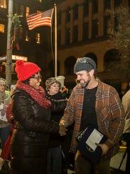 York City Mayor Kim Bracey, left, shakes hands with