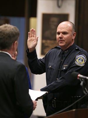 Indianapolis Mayor Joe Hogsett swears in IMPD Chief Troy Riggs, Monday, April 4, 2016, in the public assembly room at the City-County Building.