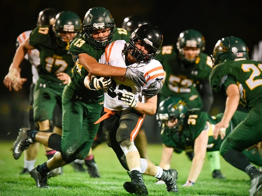 St. Cloud Tech's Drew Kiffmeyer is brought down by Sauk Rapids linebacker Justin Fabian during the second half Friday in Sauk Rapids.
