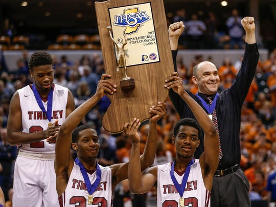 The Tindley Tigers hoist the IHSAA Class A state championship