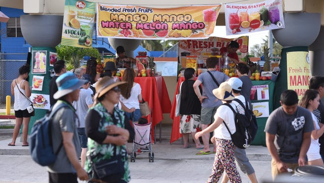 Island residents and visitors arrive early to experience the weekly Wednesday Night Market, as well as the opening of the 73rd Liberation Day carnival, at the Chamorro Village in Hagåtña on Wednesday, July 12, 2017.