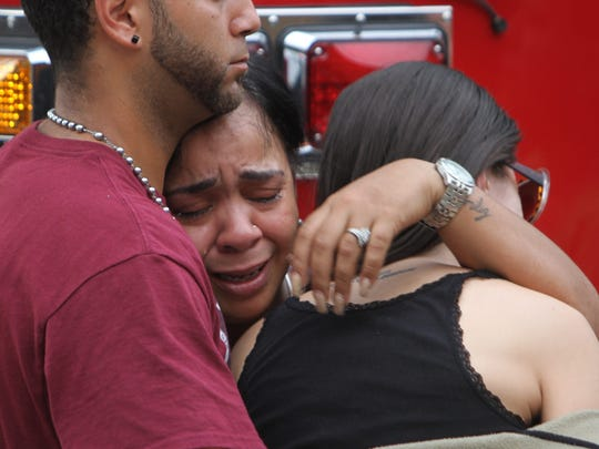 An unidentified woman is consoled at the Hampton Inn and Suites near the Orlando Health Center on 6/12/2016.  The hotel was taking in family and friends of those killed and injured in a mass shooting at the Pulse night club in Orlando.