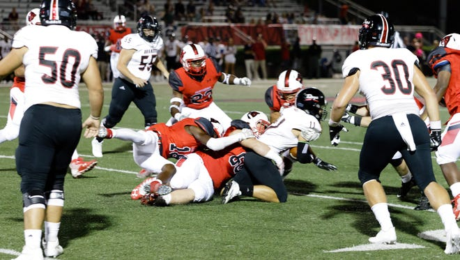 Brandon's Bo Whatley is brought down by the Petal Panthers during their game Friday.